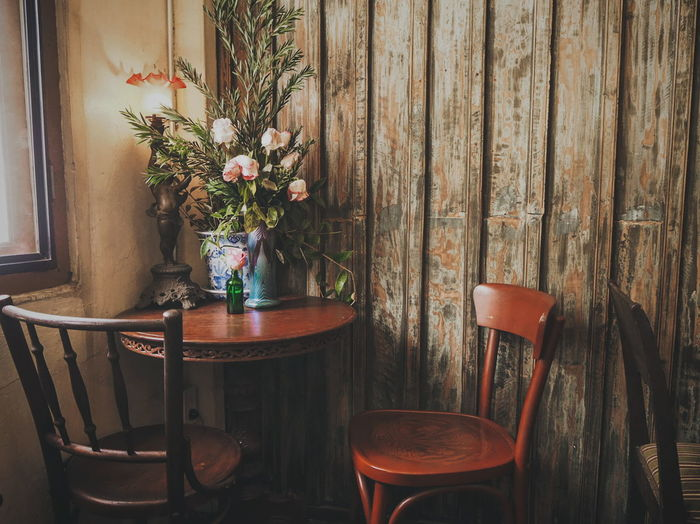 Potted plants on table in restaurant