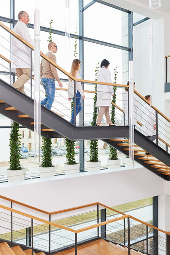 people standing on staircase Adult Architecture Clinic Colleagues Cooperation Coworker Doctor  Doctors Employee Female Doctor Females Full Length Group Group Of People Health Healthcare Hospital Indoors  Job Lifestyles Males  Man Medical Medical School Men People Physician Profession Professional Railing Real People Staff Staircase Standing Steps And Staircases Studies Team Team Of Doctors Three Quarter Length Together Togetherness Uni University Woman Women Work Young Adult Young Women