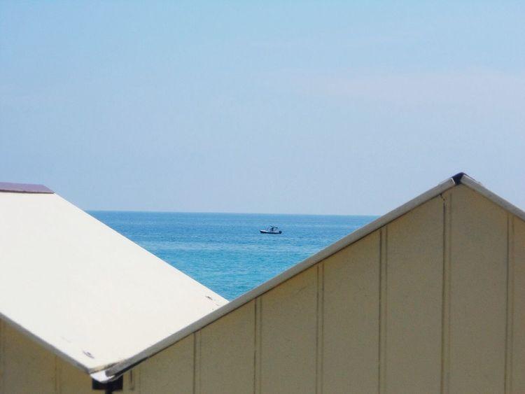Beach huts at Bordighera Italy Beach Huts Sea And Sky Small Boat Bordighera Italy Summer ☀