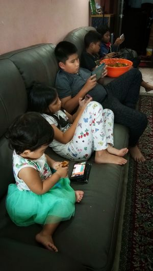 Kids holding handphone Sitting Childhood Daughter Baby Family People Domestic Life Indoors  Love Wireless Technology Child Holding Real People Full Length Girls Togetherness Three People Innocence Casual Clothing Sofa Leisure Activity Elementary Age Day Lifestyles Indoors