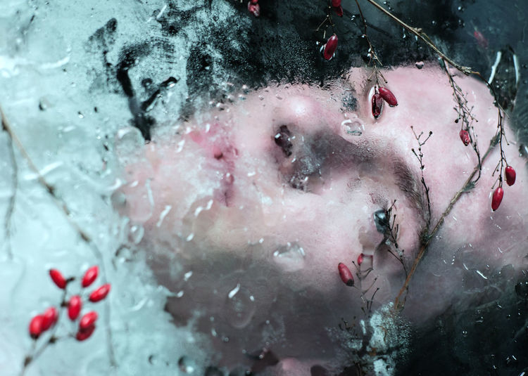 Close-up of man in frozen water