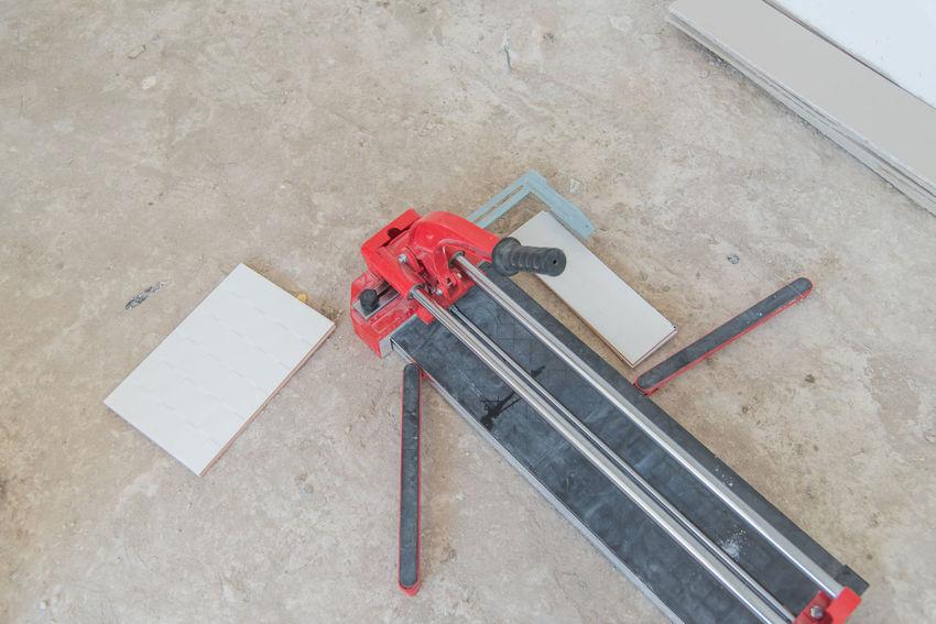 Construction Construction Site Cut Cut Tile Cutting Floor Industrial Industrial Tiler Install Installing Tile Tiled Tiled Floor Worker Working