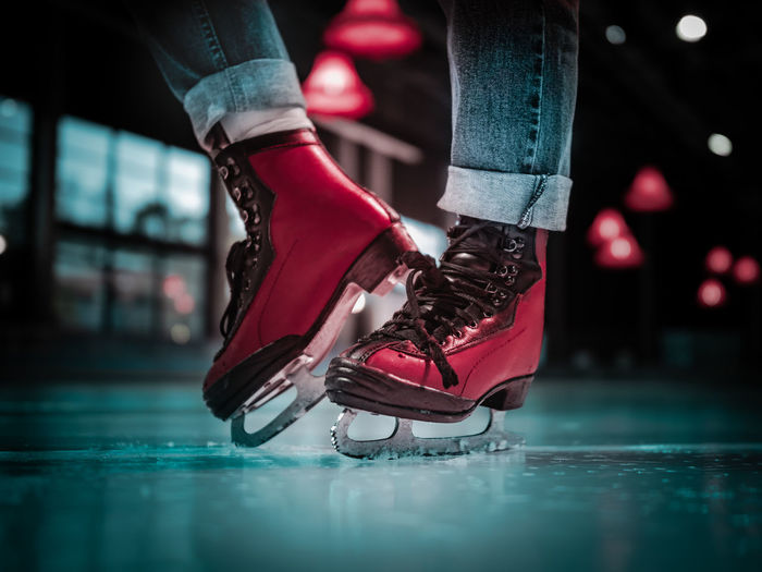 Low section of woman in ice skate