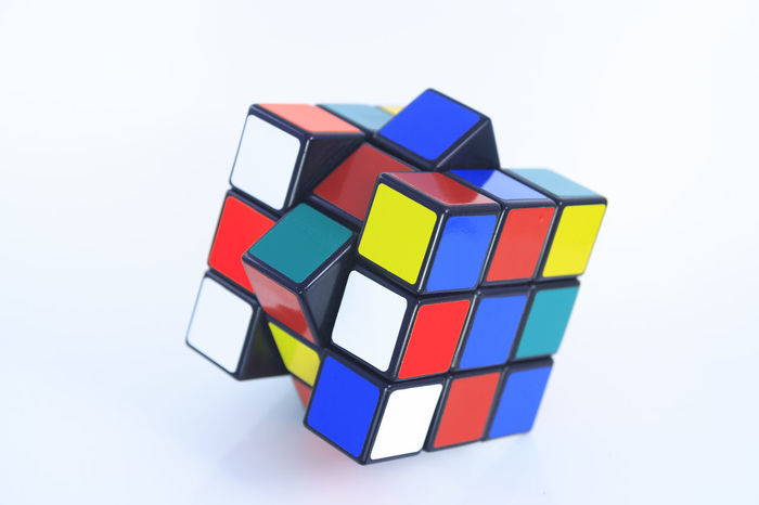 Rubik's cube on the white background 3D Brain Classic Close Up Close-up Colour Cube Difficult Entertainment Famous Hungarian Logic Mind  Multicolor Old Pattern Puzzle  Repetition Rubic RubicsCube Solution Solutions Square Think Toy