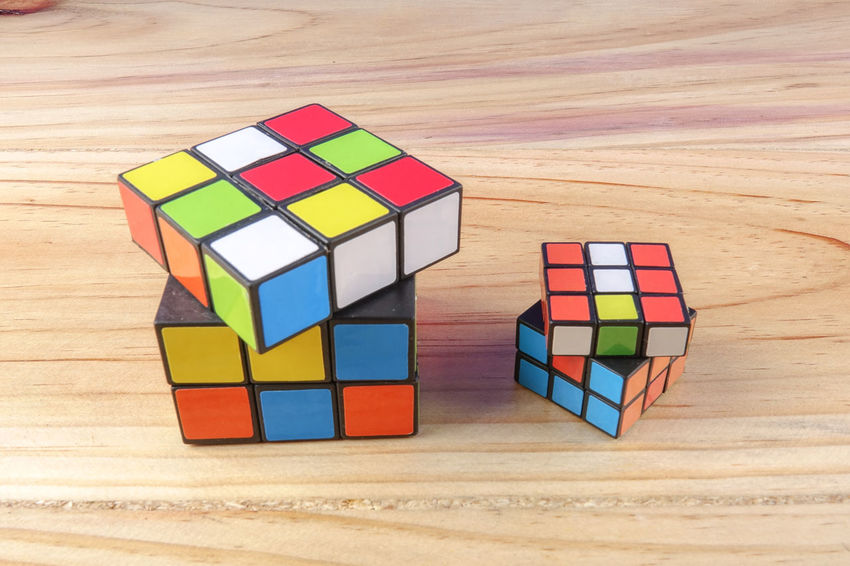 RUBIK'S CUBE , CREATIVITY TOY Creativity Rubik Cube Block Choice Circle Creativity Cube Shape Design Geometric Shape High Angle View Indoors  Intelligence Multi Colored No People Puzzle  Rubik Shape Still Life Table Toy Toy Block Variation Wood - Material