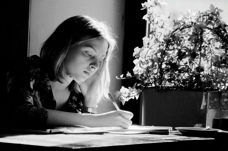 Black And White Girl Studying Student Writer Writing Instrument Sunny Day Window On The Table Child Table Close-up Posing The Portraitist - 2018 EyeEm Awards The Photojournalist - 2018 EyeEm Awards