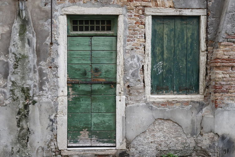 Water level door and window - old and weathered Door Window Building Exterior Old No People Day Building Closed Wood - Material Deterioration Weathered Outdoors