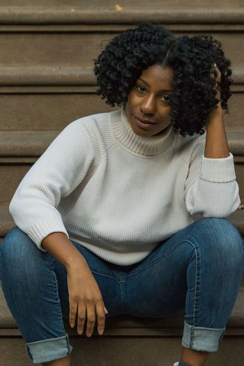 Kisha Johnson, Brooklyn NYC 2016 One Person Sitting Real People Casual Clothing Lifestyles Front View Leisure Activity Young Adult Portrait Looking At Camera Relaxation Adult Looking Jeans Hairstyle