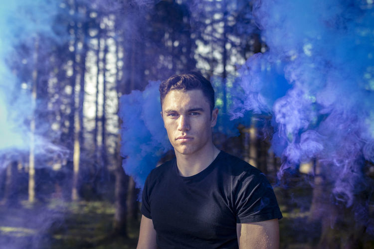 Blue Casual Clothing EyeEmNewHere Focus On Foreground Looking At Camera One Man Only Portrait Smoke Sunlight Woods