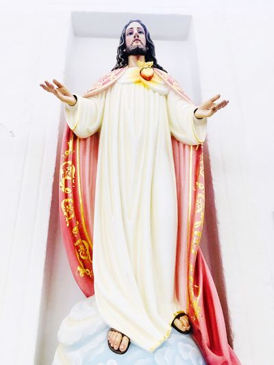 Religious statue of Jesus Christ Catholic Jesus Christ Statue Belief Religion Spirituality One Person Indoors  Clothing Traditional Clothing Front View Young Adult White Color Place Of Worship