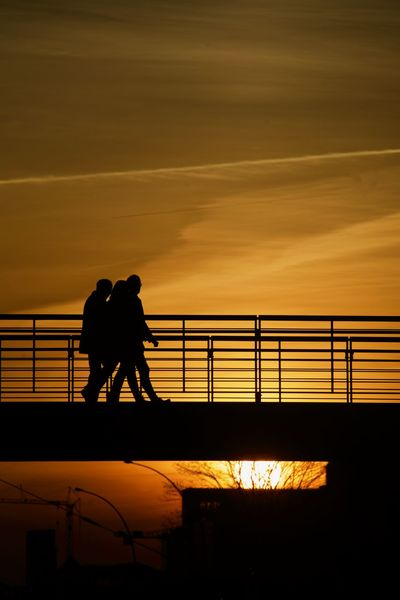 Bridge and Sunset Paint The Town Yellow Railing Silhouettes Black Brigde Orange Colour People Sky Sunset Yellow