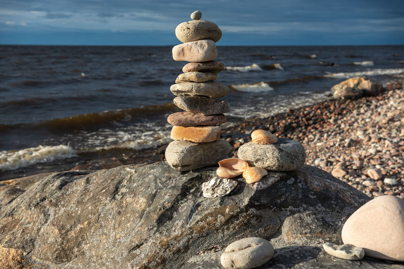 Beautiful natural stones that are stacked by the swedish baltic sea on an empty pebble beach
