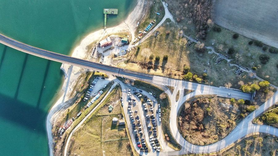 Drone view of cars by bridge over river