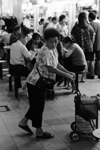 Fujifilm_xseries Fujifilm FUJIFILM X-T2 FujiAcros Streetphotography Street Photography Street Streetphoto_bw Fujinon 23mm F1.4 Fujinon23mm Noiretblanc Full Length Crowd Men Women Music Sitting Togetherness EyeEmNewHere