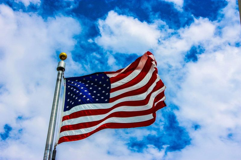 White stripes Patriotism Flag Sky Cloud - Sky Striped Low Angle View Wind No People Red Pole Blue Pride Star Shape Freedom Independence