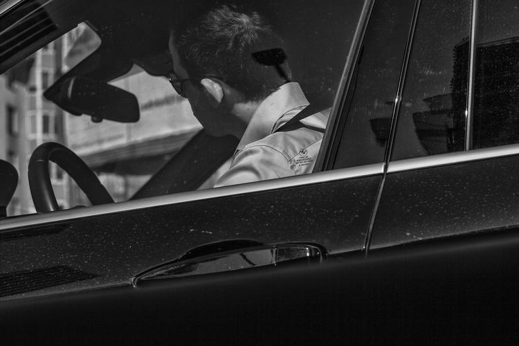 Adult Adults Only Car Car Interior Day Headshot Human Body Part Journey Looking Through Window Mode Of Transport One Person One Woman Only Only Women Outdoors People Photography From Car Real People Reflection Transportation Travel Window