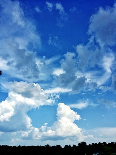 cloudy blue sky Above Blue Sky Cloud - Sky Calm Cloudscape