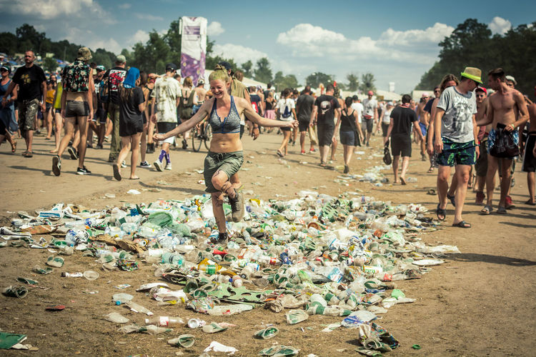 Real People Day Crowd Group Of People Large Group Of People Men Garbage Nature Environment Lifestyles Standing Celebration Event Adult Casual Clothing Leisure Activity Sky Land Outdoors Messy Festival Pollution Plastic Waste