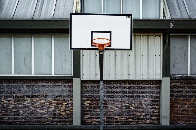 Basketball hoop against building
