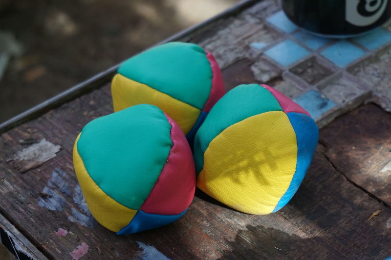 High Angle View Of Colorful Juggling Balls On Table