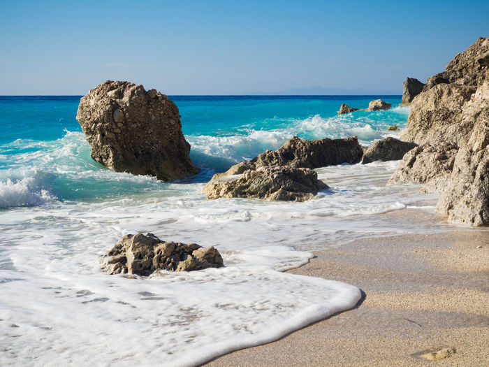 Waves at Calamitsi beach on Lefkada, Greece Beach Beauty In Nature Blue Clear Sky Day Greece Horizon Over Water Lefkada Nature No People Outdoors Rock - Object Sand Scenics Sea Sky Travel Destinations Water Wave