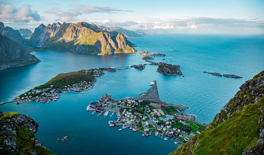 High angle view of sea and mountains against sky, lofoten, norway