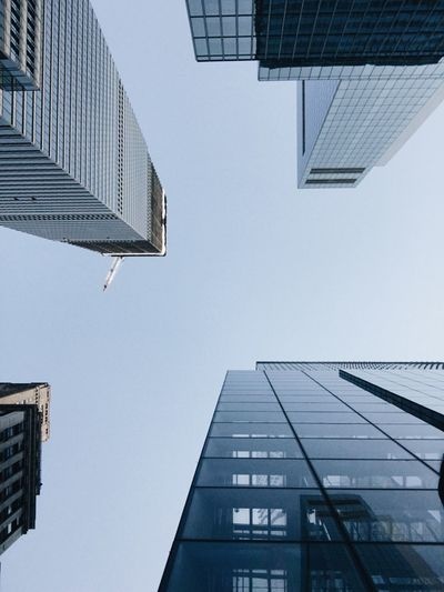 Low angle view of modern buildings against clear sky, new york
