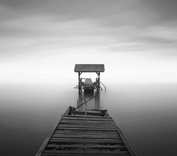 Wooden Broken Pier On Calm Sea