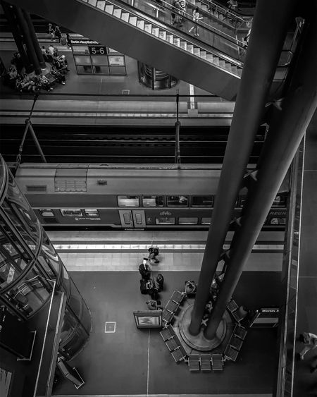 Indoors  Public Transportation Transportation Rail Transportation Train - Vehicle Built Structure Architecture Technology Real People Blackandwhite Photography Bnw Monochrome Black And White Black & White EyeEm Awards 2017 High Angle View Modern Architecture Travel Destinations Architecture Travel Staircase Station Steps And Staircases