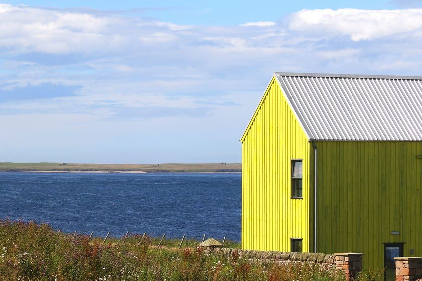 Paint The Town Yellow Sea Built Structure Outdoors Building Exterior Sky Cloud - Sky Architecture Day No People Water Vacations Horizon Over Water Scotland Sunlight Summer Coastline Cliffs North Coast 500 Yellow Wall Yellow Scenics Tranquil Scene