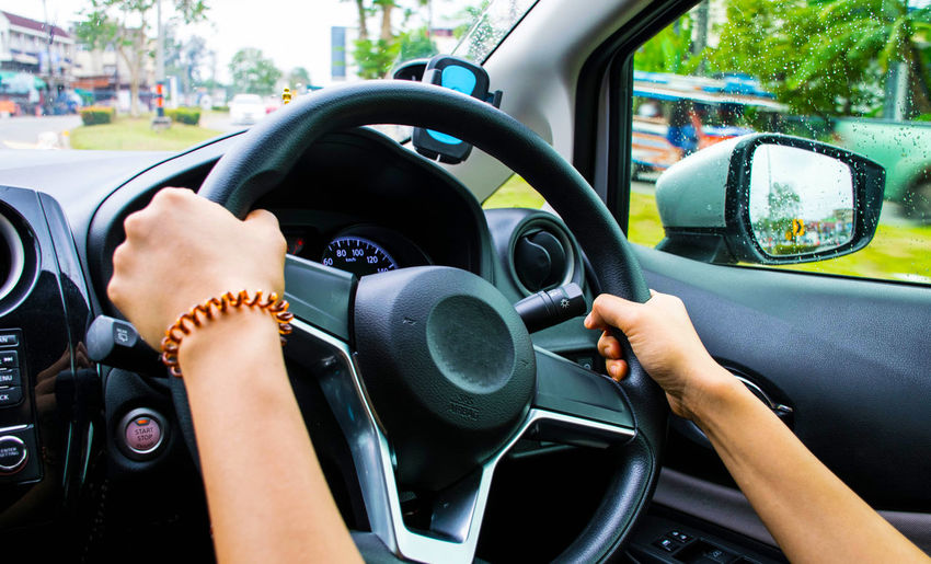 Car Car Interior Close-up Dashboard Day Driving Human Body Part Human Hand Journey Land Vehicle Men Mode Of Transport One Person Outdoors People Real People Road Speedometer Steering Wheel Transportation Travel Windscreen
