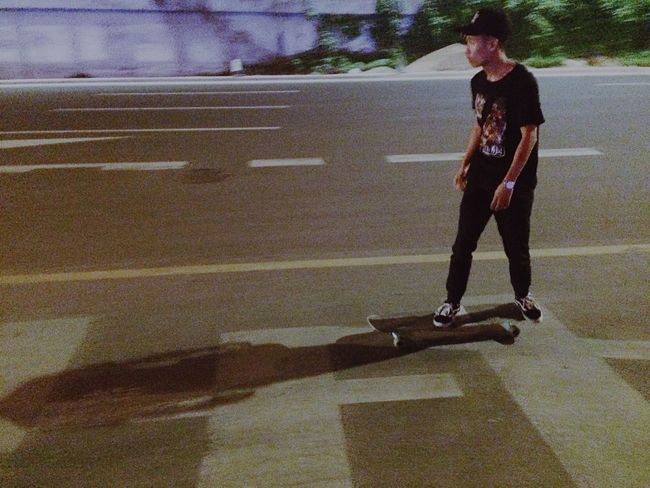 Full Length Road Shadow One Person Leisure Activity Outdoors Day Lifestyles Real People Standing Sport Young Adult Adult People Adults Only Skateboarding