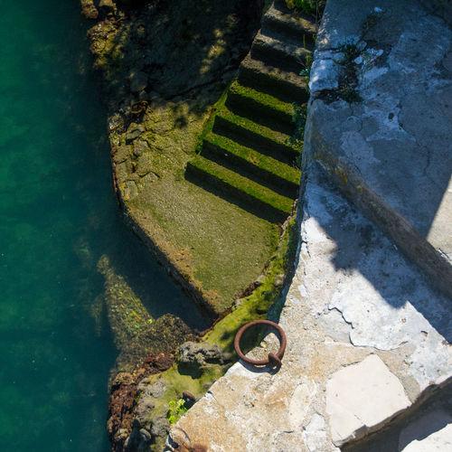 High angle view of steps and sea