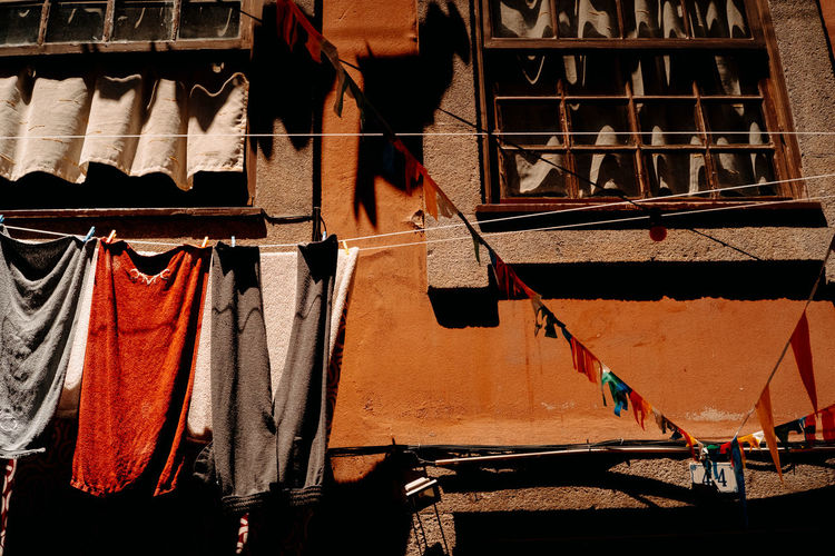 Clothes drying on clothesline outside building