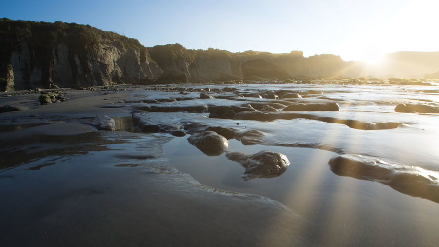 Tirmonana beach and tidepools New Zealand Landscape Beach Beauty In Nature Black Sand Beach Clear Sky Day Iceberg Nature No People Outdoors Scenics Sky Sunlight Sunset Tidepools Tranquil Scene Tranquility Water