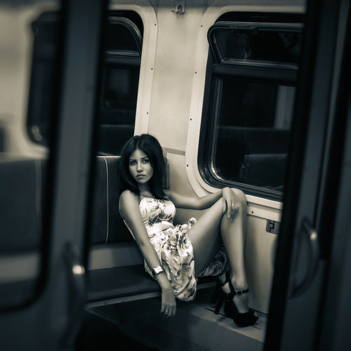 Woman sitting on train
