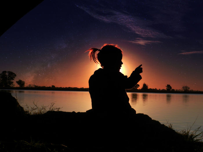 Silhouette of girl by the lake