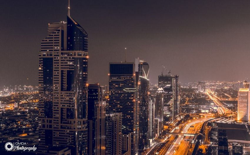 City Night Illuminated Architecture Cityscape Building Exterior Dusk Urban Skyline Transportation Modern Travel Destinations Long Exposure Sky Speed Business Finance And Industry No People Outdoors Futuristic Downtown District