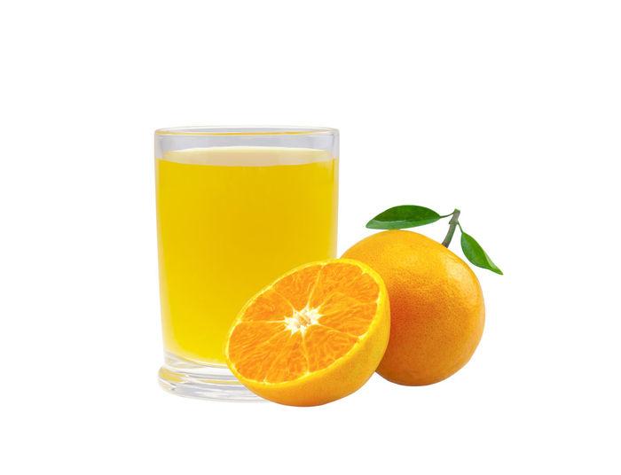 Orange fruit against white background