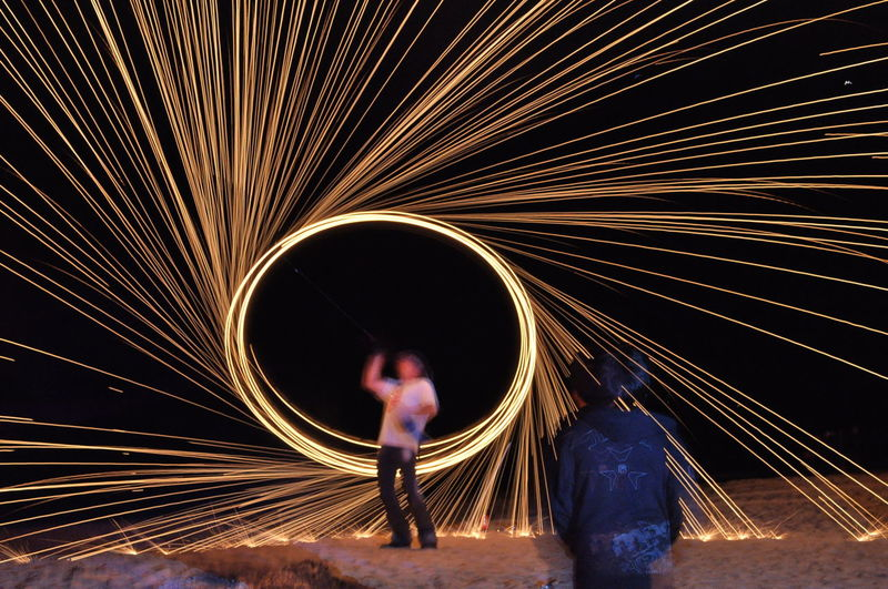 Fire performer Adult Adults Only Blurred Motion Full Length Glowing Illuminated Lifestyles Light Effect Light Trail Long Exposure Men Motion Night One Person Outdoors People Performance Real People Skill  Sparkler Speed Standing Wire Wool Women Young Adult Breathing Space