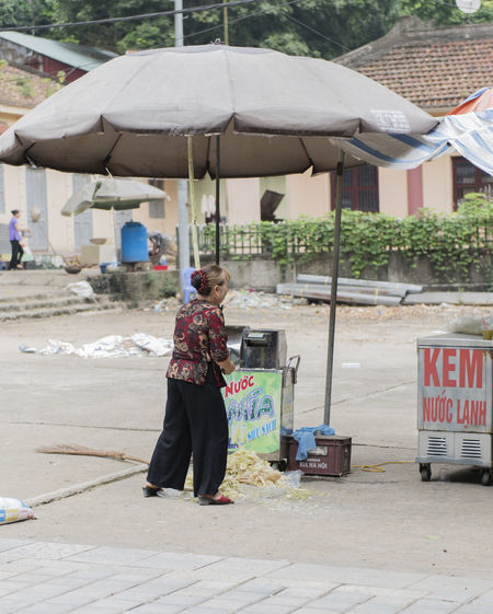 Vietnam, Hanoi - October 21, 2016: Vietnamese street vendors act and sell their vegetables and fruit products in Hanoi, Vietnam Baskets Centrally Vietnam Hanoi, Vietnam Huế Tourist Trip Vegetable Market Vietnam Vietnamese Vietnamese Population Concept Editorial  Fruit Hanoi Hanoi Vietnam  Imperial City Sell Slum Street Shop Assistants Trade Vacation Vegetables