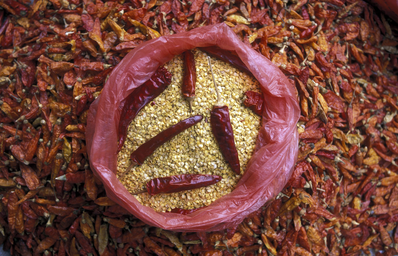 High Angle View Of Red Chili Seed In Plastic Bag