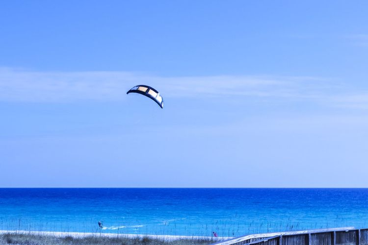 Looks lIke fun Adventure Beach Beauty In Nature Blue Day Flying Horizon Over Water Leisure Activity Lifestyles Nature Outdoors Paragliding Parasailing People Scenics Sea Sport Unrecognizable Person Vacations Water