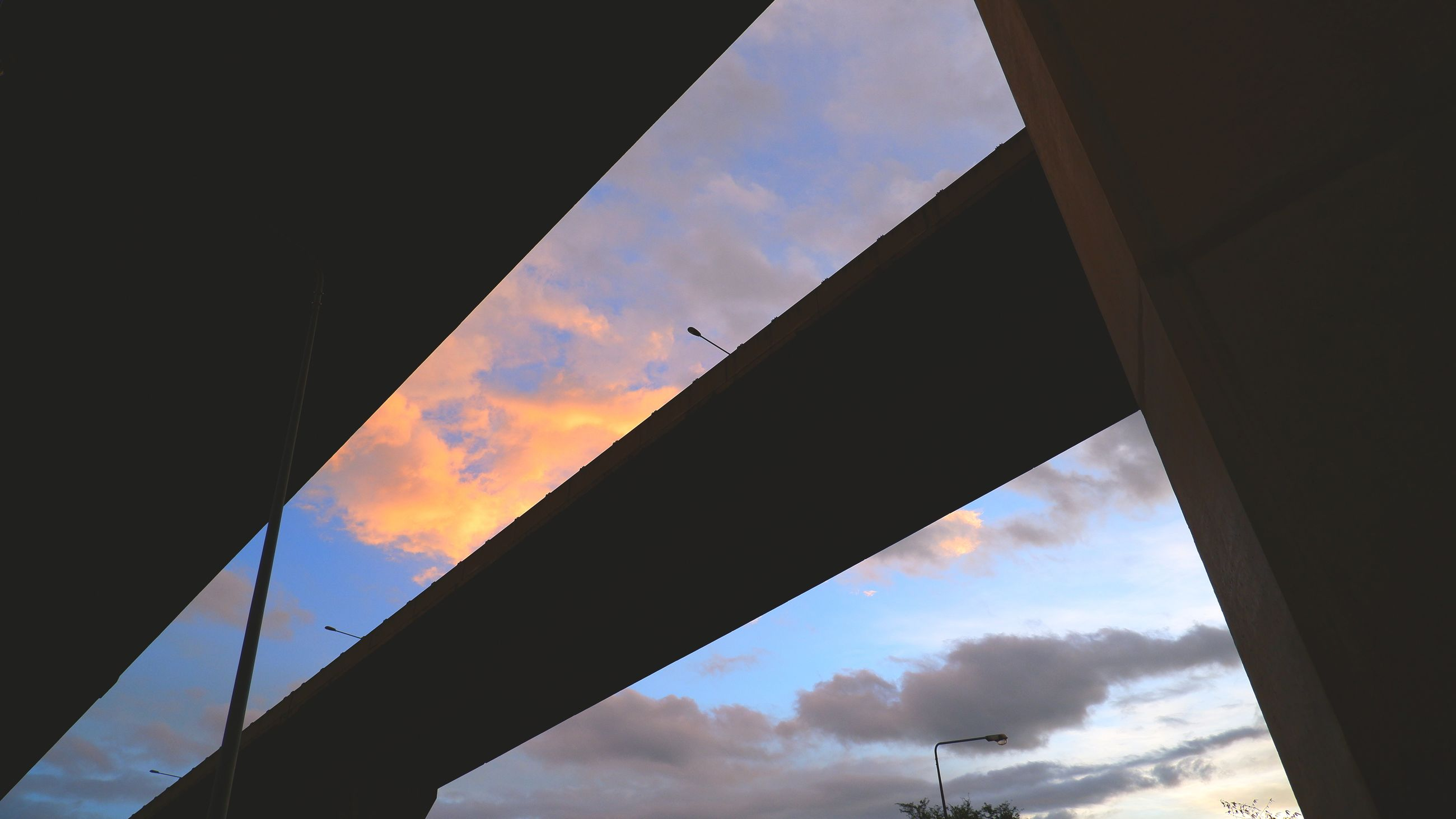 sky, cloud, architecture, light, reflection, built structure, nature, silhouette, no people, sunlight, low angle view, transportation, blue, outdoors, sunset, window