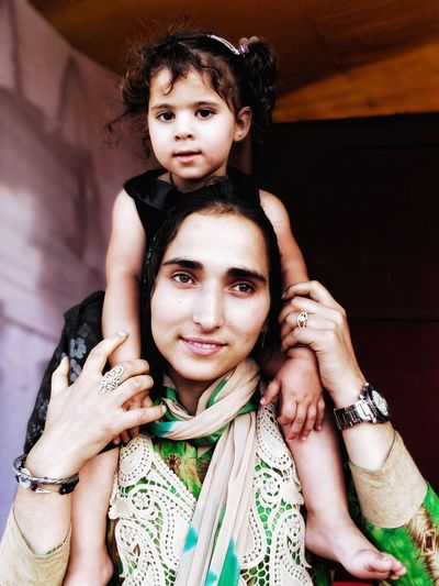 The mother's love Cultures Kashmir Kashmir , India Kashmirdiaries Kashmir Beauty Friendship Bride Portrait Child Togetherness Looking At Camera Human Hand Arts Culture And Entertainment Bonding Close-up Nail Polish Henna Tattoo Wedding Ceremony Ring Groom Red Nail Polish Ceremony EyeEmNewHere