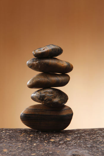 Close-up of stack of stones on table