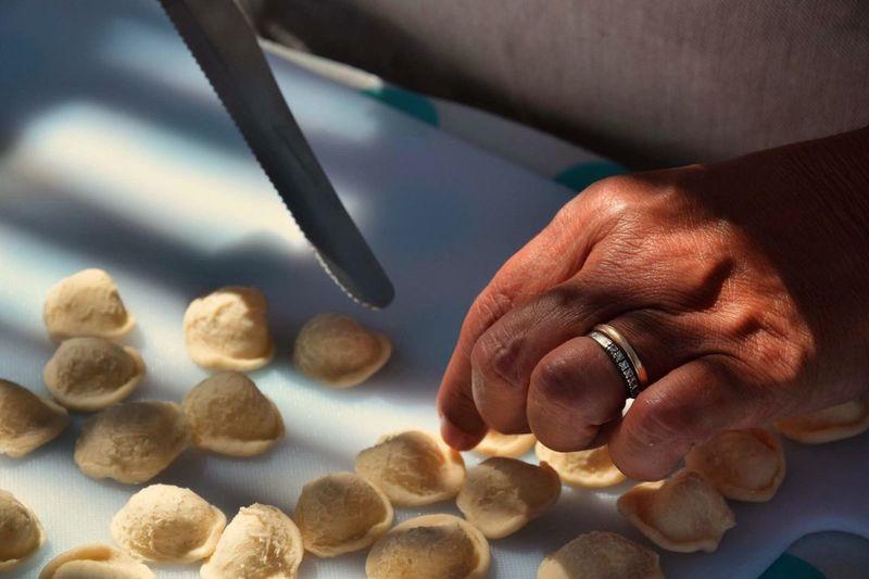 Cropped Hand Preparing Food