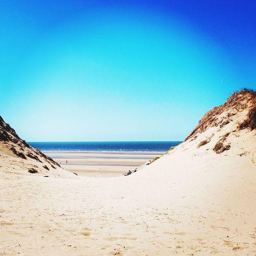 Empty beach against sky