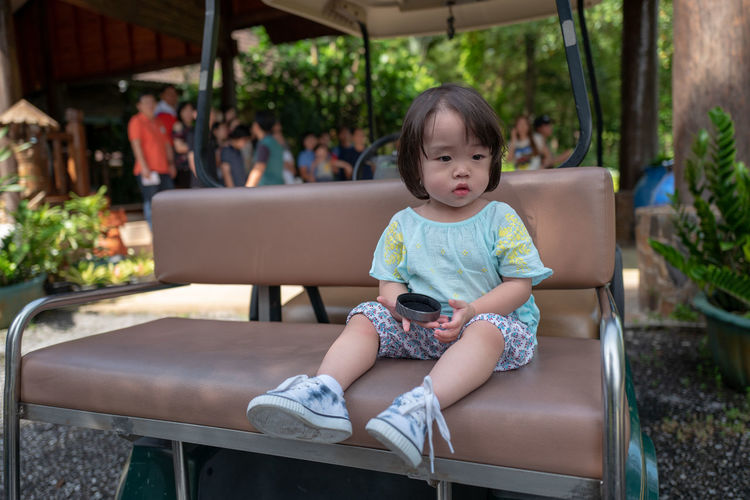 Casual Clothing Chair Child Childhood Cute Females Focus On Foreground Front View Girls Innocence Leisure Activity Lifestyles Looking One Person Real People Seat Sitting Women