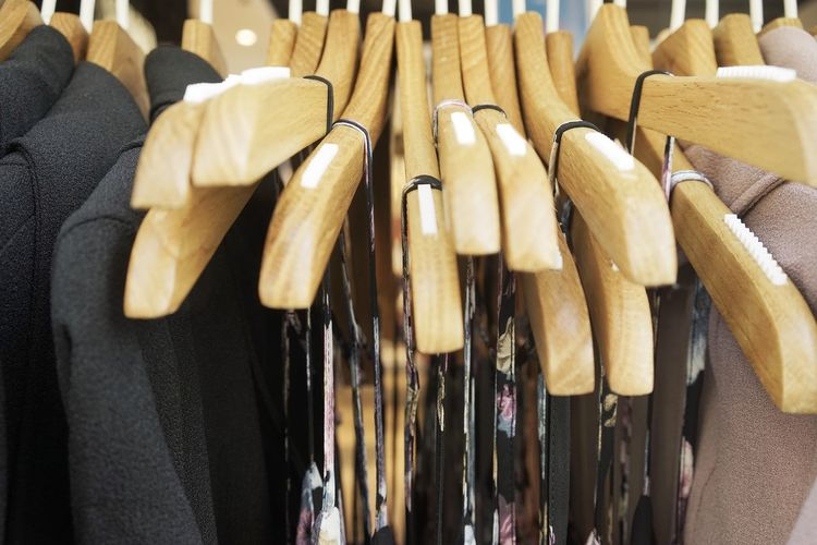 Close-Up Of Ties And Blazers Hanging From Hangers